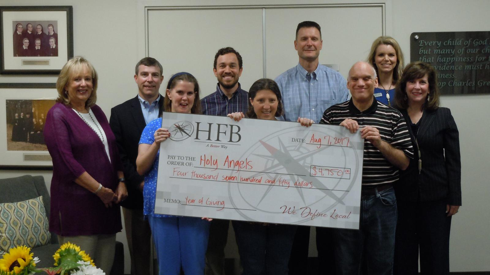 Donation presentation to Holy Angels